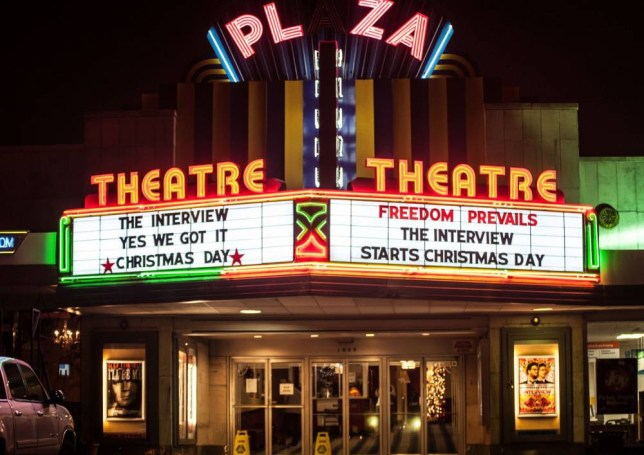 """ATLANTA, GA - DECEMBER 25:  General view of the Plaza Theatre marquee during Sony Pictures' release of """"The Interview""""  at the Plaza Theatre on, Christmas Day, December 25, 2014 in Atlanta, Georgia. Sony hackers have been releasing stolen information and threatened attacks on theaters that screened the film.  (Photo by Marcus Ingram/Getty Images)"""