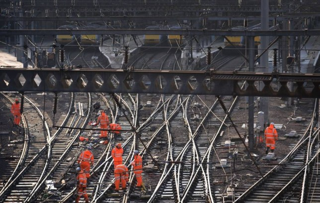 Railway workers on the tracks outside King's Cross, London, as trains in and out of the station have been cancelled because of overrunning Network Rail engineering works north of the station, with a reduced service tomorrow. PRESS ASSOCIATION Photo. Issue date: Saturday December 27, 2014. All East Coast and Thameslink & Great Northern passengers must start or end their journey at Finsbury Park in north London, with at least one change of train, Network Rail said. See PA story RAIL KingsCross. Photo credit should read: Stefan Rousseau/PA Wire