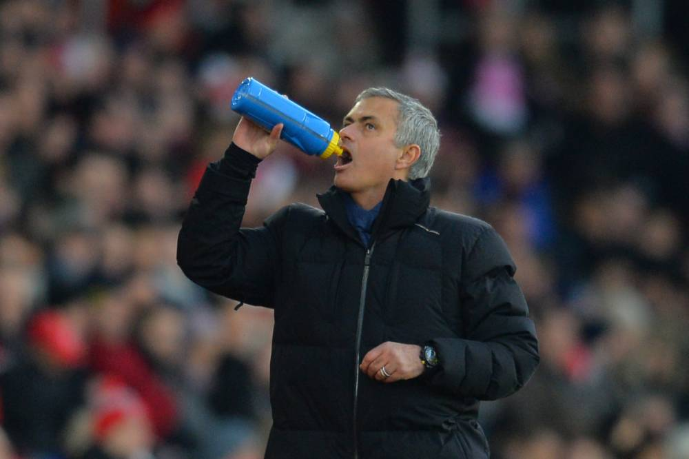 Chelsea's Portuguese manager Jose Mourinho has a drink during the English Premier League football match between Southampton and Chelsea at St Mary's Stadium in Southampton, southern England, on December 28, 2014. AFP PHOTO / GLYN KIRK  RESTRICTED TO EDITORIAL USE. No use with unauthorized audio, video, data, fixture lists, club/league logos or live services. Online in-match use limited to 45 images, no video emulation. No use in betting, games or single club/league/player publications.GLYN KIRK/AFP/Getty Images