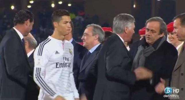 Cristiano Ronaldo avoids shaking hands with Michel Platini