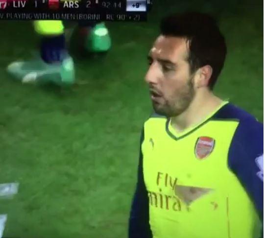 Liverpool striker Fabio Borini sent off against Arsenal for exposing Santi Cazorla's nipple with high challenge