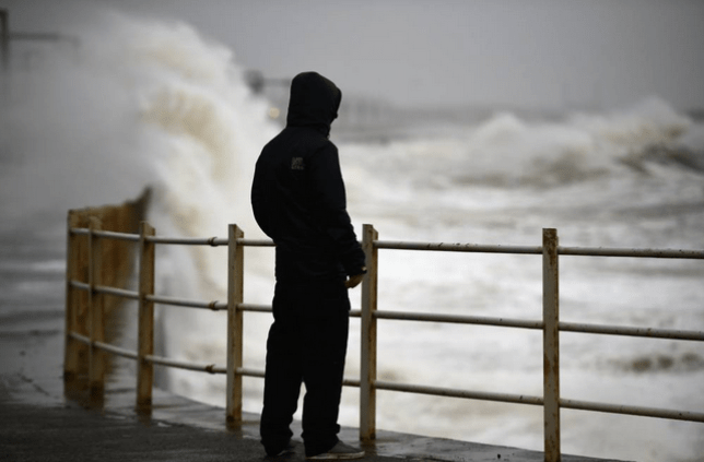 A man ponders what a 'weather bomb' is while staring out at the ongoing storm on the west coast of Scotland (Picture:Jeff J Mitchell/Getty Images)