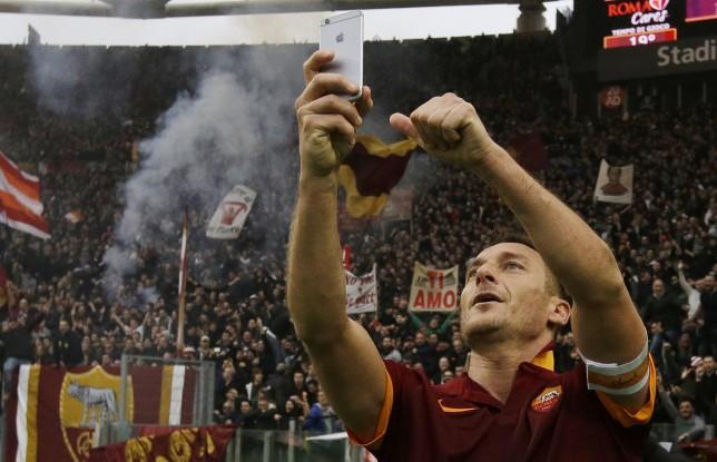 Francesco Totti celebrates equaliser for Roma against Lazio with mid-game selfie