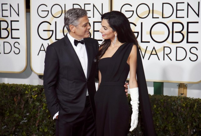 Actor George Clooney and wife, Amal Clooney, arrive at the 72nd Golden Globe Awards in Beverly Hills, California January 11, 2015. REUTERS/Danny Moloshok (UNITED STATES - Tags: ENTERTAINMENT)(GOLDENGLOBES-ARRIVALS) Danny Moloshok/Reuters