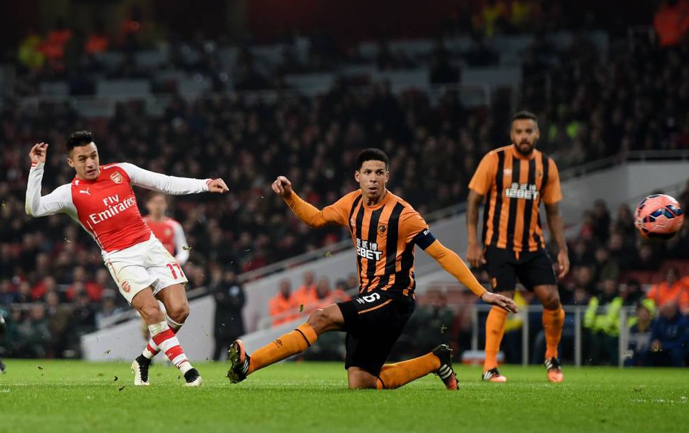 """Football - Arsenal v Hull City - FA Cup Third Round - Emirates Stadium - 4/1/15  Alexis Sanchez scores the second goal for Arsenal  Mandatory Credit: Action Images / Alan Walter  Livepic  EDITORIAL USE ONLY. No use with unauthorized audio, video, data, fixture lists, club/league logos or """"live"""" services. Online in-match use limited to 45 images, no video emulation. No use in betting, games or single club/league/player publications.  Please contact your account representative for further details."""