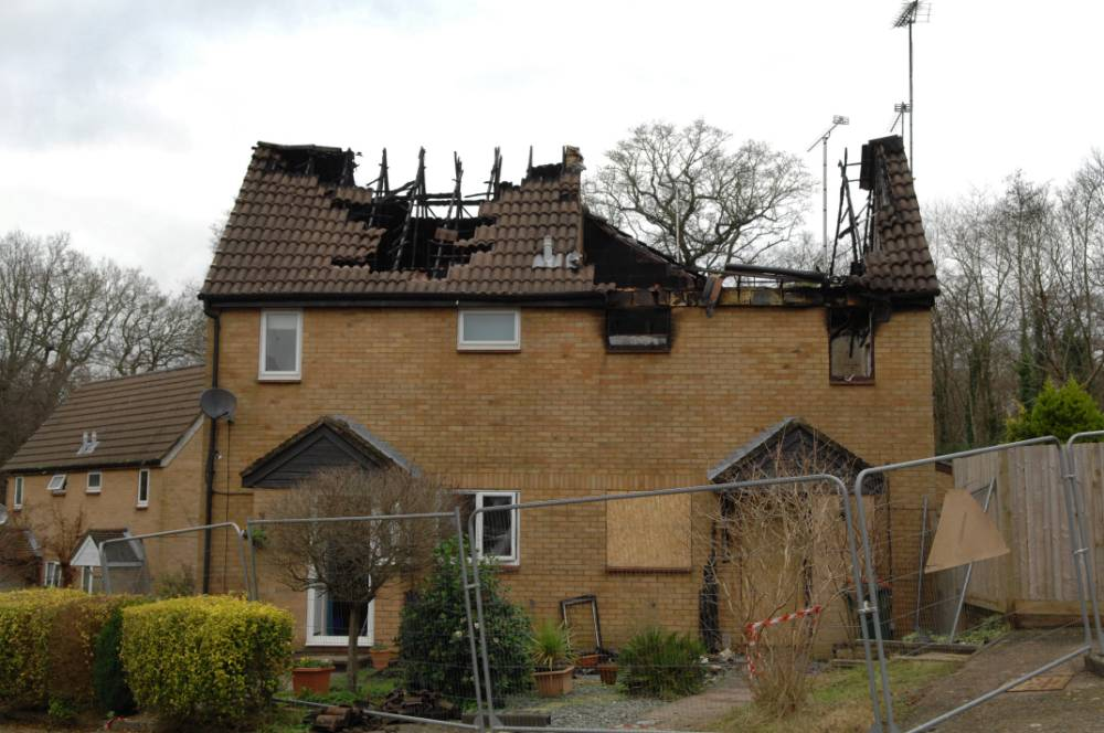"""A man reckons he's lucky to be alive after going back to sleep when he was woken by the sound of fire burning this house - because he thought it was a SQUIRREL. See SWNS story SWFIRE: Nathan Harrison was woken by a strange tapping noise coming from the roof above his bed, which he put down to a bushy rodent and nodded off. But half an hour later, the 37-year-old was woken again, and this time realised his roof was on fire. Nathan, of Crawley, West Sussex, said: """"I woke up at half two in the morning, and there was a tapping, popping sound coming from the roof."""
