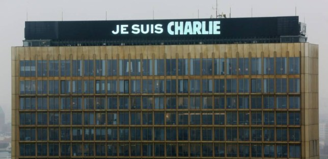 "The lettering ""Je suis Charlie"" (I am Charlie) is displayed on the roof of the German Axel Springer publishing group headquarters in Berlin on January 8, 2015 in commemoration of the victims of an attack by armed gunmen on the offices of French satirical newspaper Charlie Hebdo in Paris on January 7 which left at least 12 dead and many others injured. AFP PHOTO / DPA / STEPHANIE PILICK +++ GERMANY OUTSTEPHANIE PILICK/AFP/Getty Images"