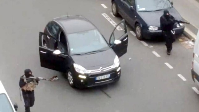 "A frame grab taken from a footage made available and posted by Jordi Mir, a local resident, on January 7, 2015 shows hooded gunmen aiming Kalashnikov rifles towards a police officer, before shooting him dead after leaving the office of the satirical weekly newspaper Charlie Hebdo. A huge manhunt for two brothers suspected of massacring 12 people in an Islamist attack at a satirical French weekly zeroed in on a northern town on January 8 after the discovery of one of the getaway cars. AFP PHOTO/ JORDI MIR  == RESTRICTED TO EDITORIAL USE - MANDATORY CREDIT ""AFP PHOTO / COURTESY OF JORDI MIR"" - NO MARKETING - NO ADVERTISING CAMPAIGNS - DISTRIBUTED AS A SERVICE TO CLIENTS ==JORDI MIR/AFP/Getty Images"