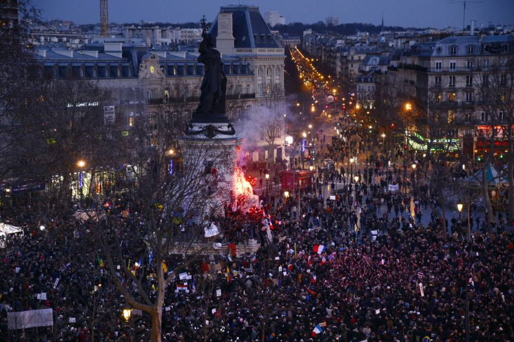 People gather on the Place de la Republique (Republic Square) in Paris during a Unity rally Marche Republicaine on January 11, 2015 in tribute to the 17 victims of a three-day killing spree by homegrown Islamists. The killings began on January 7 with an assault on the Charlie Hebdo satirical magazine in Paris that saw two brothers massacre 12 people including some of the country's best-known cartoonists, the killing of a policewoman and the storming of a Jewish supermarket on the eastern fringes of the capital which killed 4 local residents. AFP PHOTO / BERTRAND GUAYBERTRAND GUAY/AFP/Getty Images