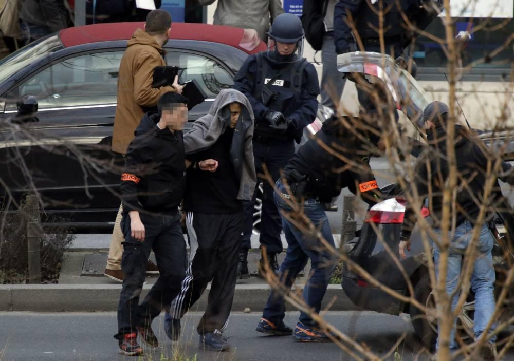 'Heartbroken' gunman who took hostages at Paris post office hands himself in