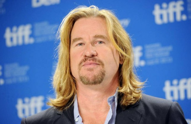 "FILE - JANUARY 30: Actor Val Kilmer was reportedly hospitalized this week with a suspected throat tumor. According to reports, he is currently recovering from surgery. TORONTO, ON - SEPTEMBER 12: Actor Val Kilmer speaks onstage at the ""Twixt"" press conference during the 2011 Toronto International Film Festival at TIFF Bell Lightbox on September 12, 2011 in Toronto, Canada. (Photo by Jason Merritt/Getty Images)"