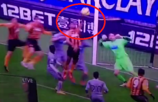 Ahmed Elmohamady tries to get away with ridiculous handball Hull City goal v Newcastle
