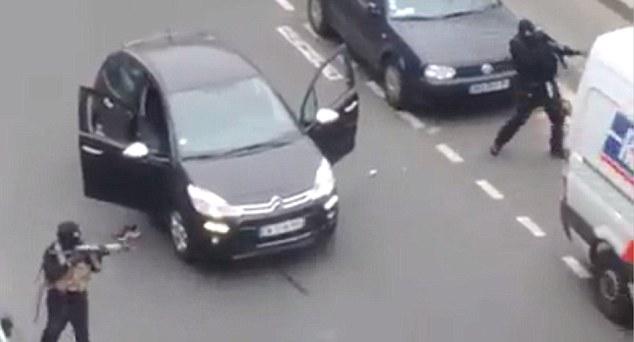 An eyewitness said the black-hooded men were carrying Kalashnikovs