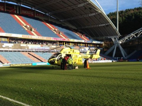 Air Ambulance lands on pitch to take Huddersfield Town's Tommy Smith to hospital after injury in Leeds defeat