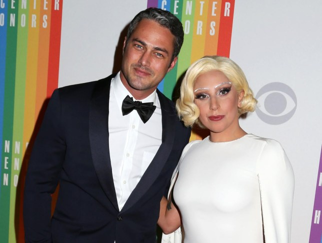 Taylor Kinney and Lady Gaga attend the 37th Annual Kennedy Center Honors in Washington. Lady Gaga announced on her Instagram account Monday, Feb. 16, 2015 that she and Kinney are engaged. (Photo by Greg Allen/Invision/AP, File) Greg Allen/Invision/AP, File