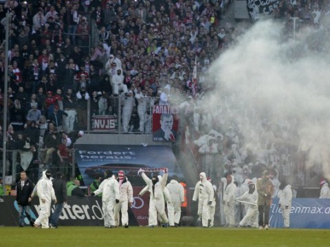 Angry Cologne fans wearing boiler suits storm pitch following last-minute local derby loss at Borussia Monchengladbach