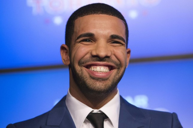 Rapper Drake smiles during an announcement that the Toronto Raptors will host the NBA All-Star game in Toronto, in this September 30, 2013, file photo. Grammy-winning rapper Drake surprised fans by releasing an album on iTunes early on February 13, 2015, following in the footsteps of pop singer Beyonce, who put out her fifth studio album with no advance notice just over a year ago. REUTERS/Mark Blinch/Files (CANADA - Tags: SPORT BASKETBALL ENTERTAINMENT) Mark Blinch/Reuters