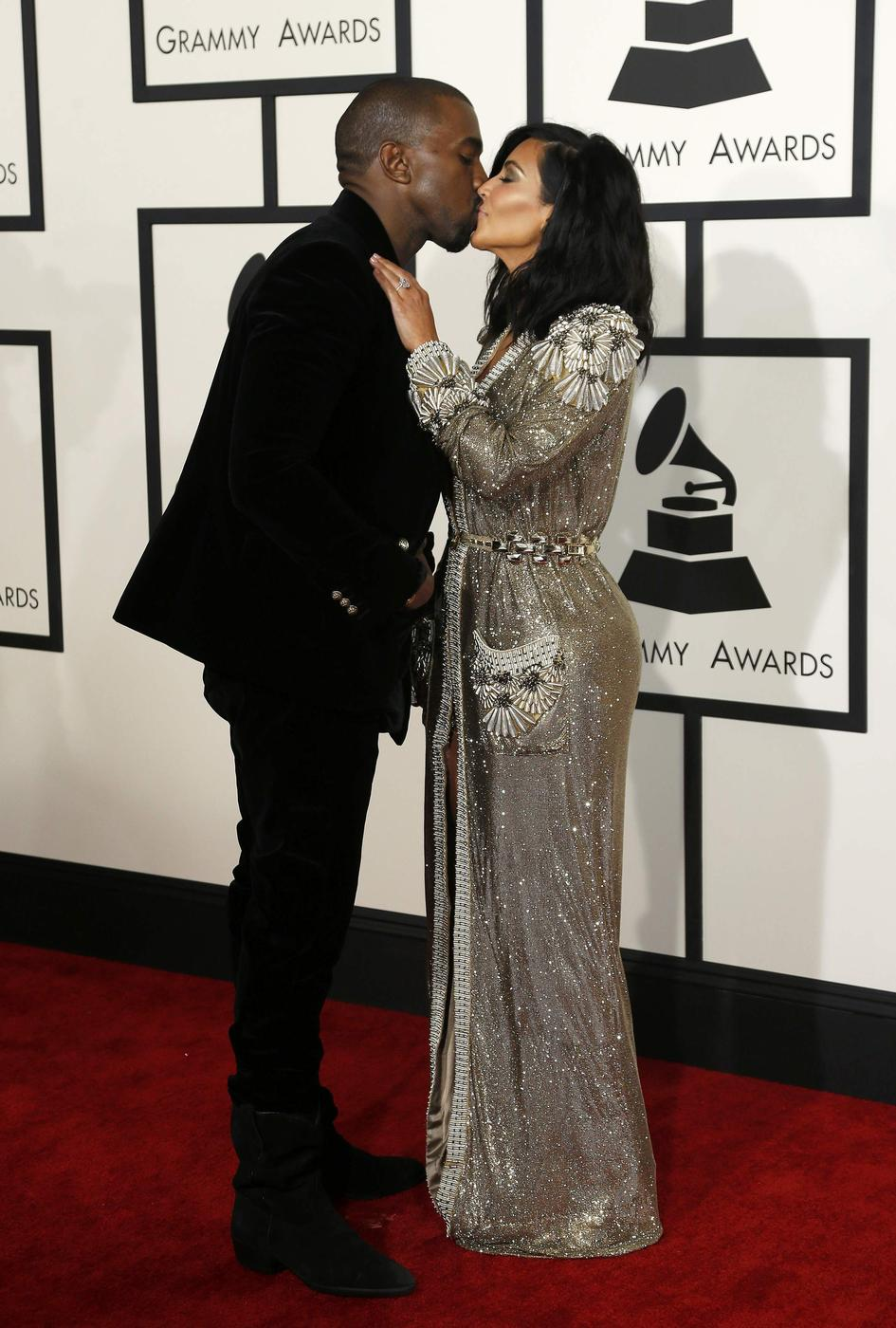 Rapper Kanye West and Kim Kardashian arrive at the 57th annual Grammy Awards in Los Angeles, California February 8, 2015. REUTERS/Mario Anzuoni (UNITED STATES - TAGS: ENTERTAINMENT) (GRAMMYS-ARRIVALS) Mario Anzuoni/Reuters