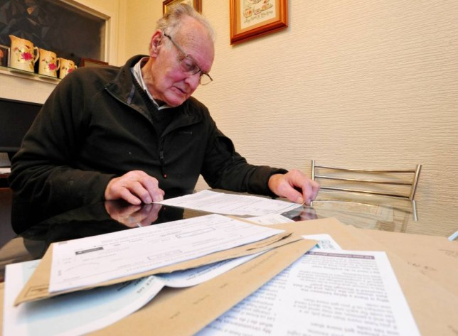 PIC FROM CATERS NEWS - (PICTURED:  - Mr Yeomans is pictured with his tax bill, which is the latest of many he has recieved since his retirement five years ago. -) A retired granddad had the shock of his life when he received a tax bill for a whopping £4.7 BILLION. Doug Yeomans, 78, received a letter from Her Majestyís Revenue and Customs saying that a £950million a month would be taken from his account. Despite originally demanding that he cough up £4,742,354,255, tax officials have now admitted the bill was an error. SEE CATERS COPY.