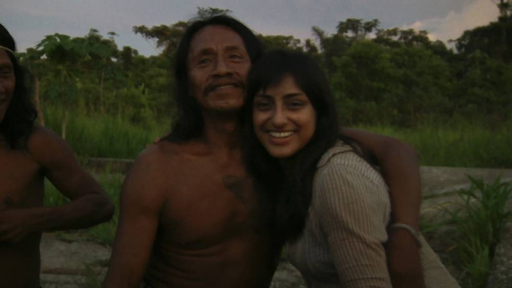 YASUNI, ECUADOR: Sarah Begum hugs her Amazon hsuband, Gintko. MEET the London girl who is now a real-life Queen of the Amazon after marrying a tribal warrior. Adventuress Sarah Begum (26) travelled to the heart of the Ecuadorian jungle on a mission to make a film about the tribes she would encounter. Little did she know they would insist she married one of their own so she could be crowned the Queen of their tribe. Pictures show Sarah with her warrior husband Ginkto (late 50ís) in the Yasuni National Park, Amazon. Other photos show Sarahís journey into the dark jungle, before she was welcomed with opened arms by the little-known Huaroani tribe ñ after she revealed that her dreams had led her to them.
