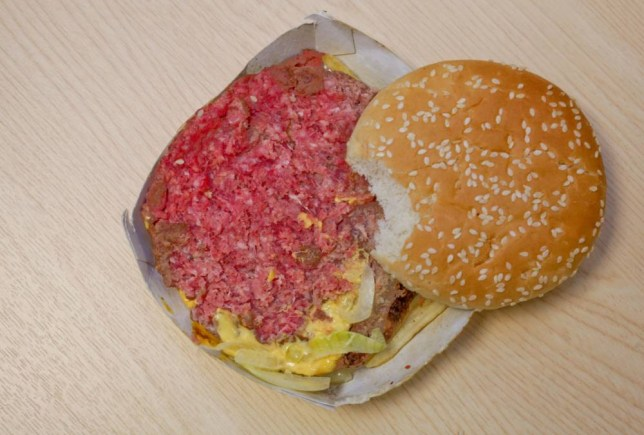 Byron Thomas from Weston Favell, Northamptonshire, with the raw quarter pounder that he bought from McDonalds.  A dad-of-two was left horrified after he bit into this McDonald's burger and found it was completely red RAW.  See NTI story NTIBURGER.  Disgusted Byron Thomas was with his stepdaughter Katie, 13, when he ordered the quarter pounder with cheese meal for £4.69 on Monday evening (9/2).  The 28-year-old took the burger back to his car but noticed a strange taste after he had his first bite.  He then looked down and was stunned when he saw that apart from the light brown top layer, the rest of the meal was totally raw.  Furious Byron stormed back into the McDonald's in Weston Favell Shopping Centre in Northampton but said the manager only offered to cook him another burger.  The dad-of-two - who suffers from Ulcerative Colitis - was then up since 4am on Tuesday (10/2) being sick and has a doctor's appoint for suspected food poisoning.  Yesterday (Wed), Byron, who lives with his partner Gail Mooney, 36, blasted McDonald's and said he would never eat there again.