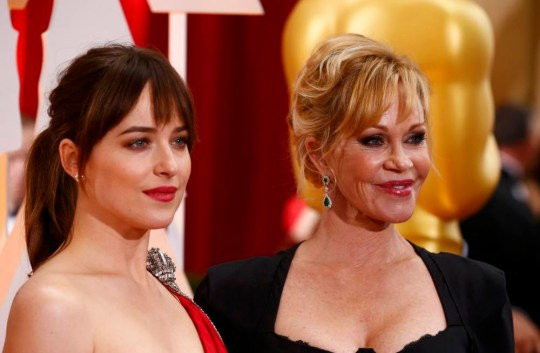 """""""50 Shades of Grey"""" actress Dakota Johnson arrives with her mother Melanie Griffith (R) at the 87th Academy Awards in Hollywood, California February 22, 2015. REUTERS/Lucas Jackson"""