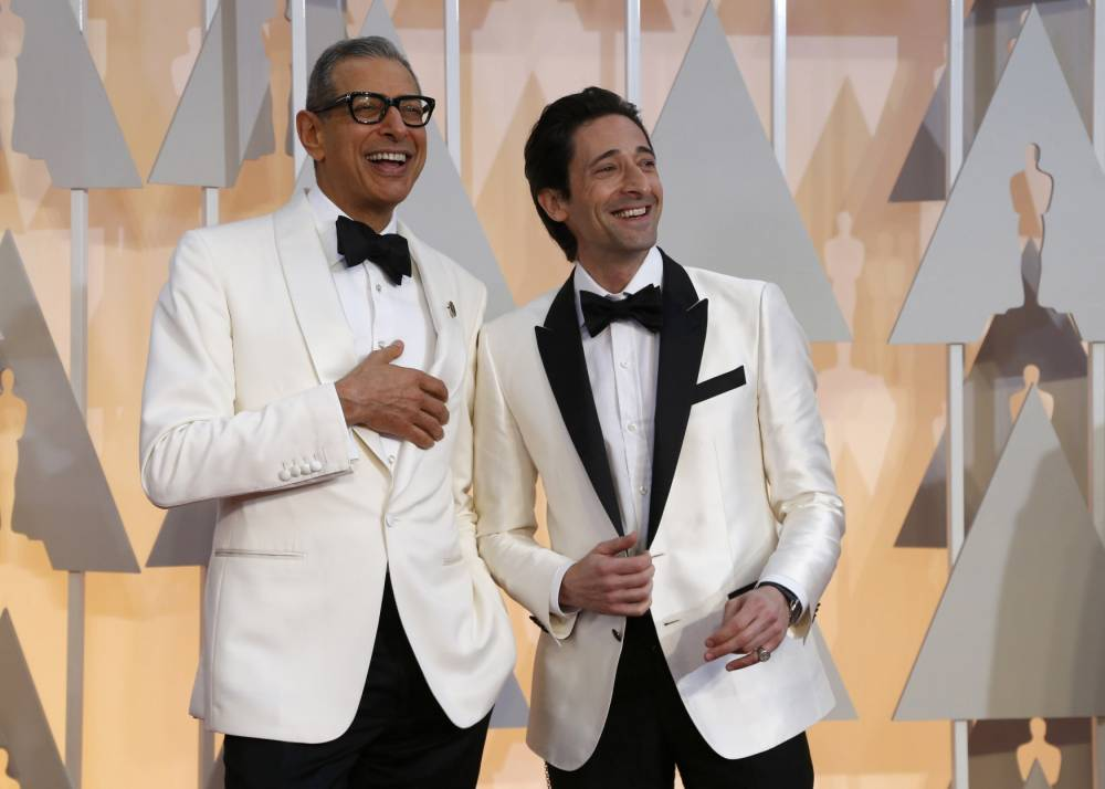 """Actors Jeff Goldblum (L) and Adrien Brody, both from the best picture nominee """"The Grand Budapest Hotel ,"""" arrive at the 87th Academy Awards in Hollywood, California February 22, 2015. REUTERS/Mario Anzuoni (UNITED STATES TAGS:ENTERTAINMENT) (OSCARS-ARRIVALS)"""