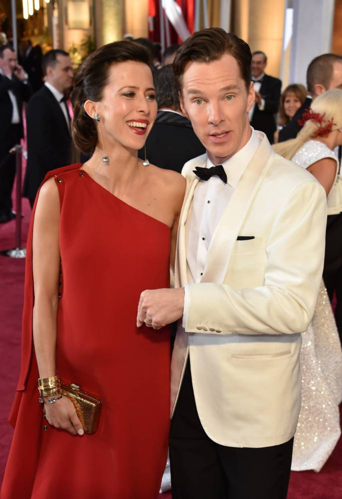 Nominee for Best Actor  Benedict Cumberbatch (R) and Sophie Hunter pose on the red carpet for the 87th Oscars on February 22, 2015 in Hollywood, California. AFP PHOTO/ MLADEN ANTONOVMLADEN ANTONOV/AFP/Getty Images