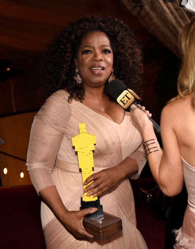 Oprah Winfrey poses with a Lego Oscar statuette at the Governors Ball after the Oscars on Sunday, Feb. 22, 2015, in Los Angeles. (Photo by Chris Pizzello/Invision/AP)