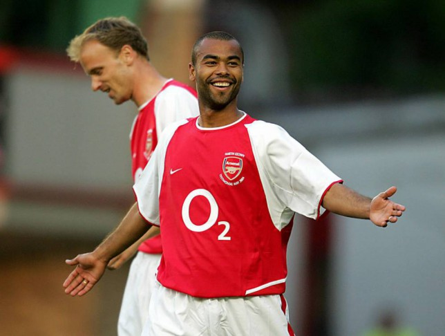 LONDON, UNITED KINGDOM:  Arsenal's Ashley Cole and Dennis Bergkamp celebrate a goal against England X1 in a testimonial football  match for Arsenal's  Martin Keown at Highbury in north London, 17 May  2004. AFP PHOTO / ODD ANDERSEN  (Photo credit should read ODD ANDERSEN/AFP/Getty Images)