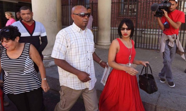 Celeste Nurse, in red, and her husband, Morné, far left, leave court in Cape Town after the woman accused of kidnapping their daughter 17 years ago was remanded in custody for a week. Photograph: AP