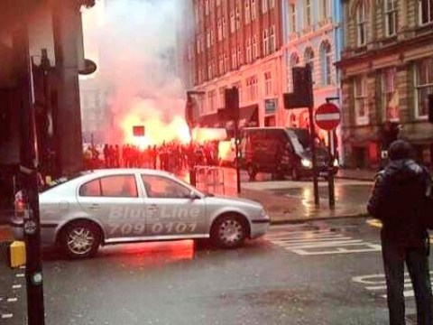 Besiktas fans let off flares and start bonfire in Liverpool streets after arriving for Europa League clash