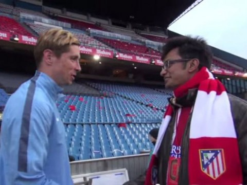 Atletico Madrid fan holds back the tears after meeting his hero Fernando Torres