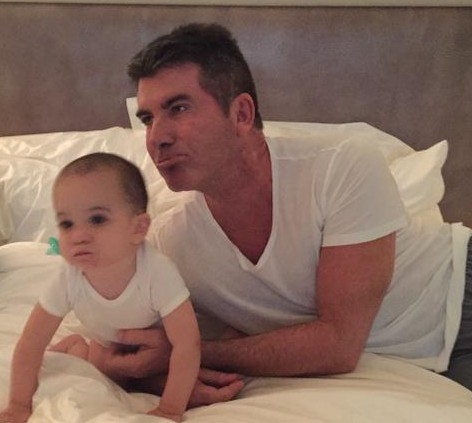 Simon Cowell hits out at grumpy airline passenger who complained about son Eric crying