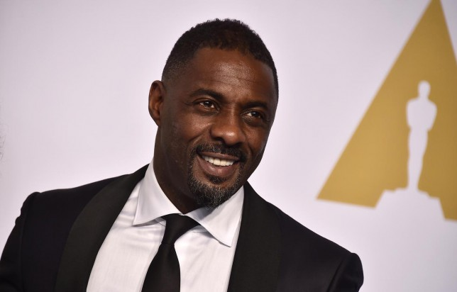Idris Elba poses in the press room at the Oscars on Sunday, Feb. 22, 2015, at the Dolby Theatre in Los Angeles. (Photo by Jordan Strauss/Invision/AP) Jordan Strauss/Invision/AP