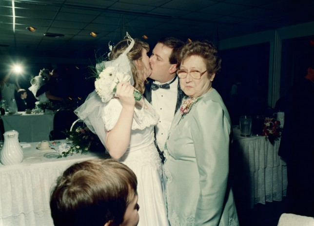 Mother-in-law looks disgusted at bride and groom kissing