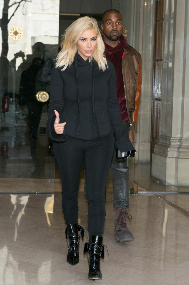 PARIS, FRANCE - MARCH 06: Kim Kardashian West and Kanye West leave the 'Givenchy' office on March 6, 2015 in Paris, France. Marc Piasecki/GC Images