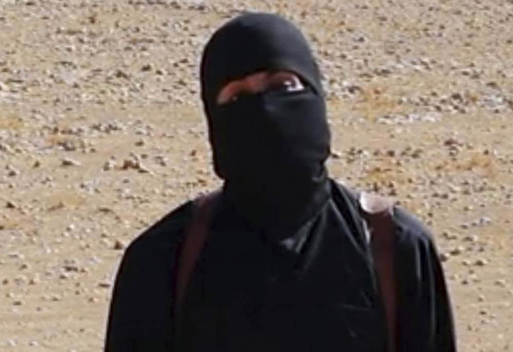 "FILE - This undated image frame grab from a video released Friday, Oct. 3, 2014, by Islamic State militants  purports to show the militant who beheaded taxi driver Alan Henning. A British-accented militant who has appeared in beheading videos released by the Islamic State group in Syria over the past few months bears ""striking similarities"" to  Mohammed Emwazi who grew up in London, a Muslim lobbying group said Thursday Feb. 26, 2015. Little known to the wider world 18 months ago, the Islamic State extremist group has muscled its way into the international spotlight by carving out a self-declared caliphate in the heart of the Mideast, beheading its opponents and foreign journalists, and attracting radicalized youth as far afield as Paris, London and New York. (AP Photo, File)"