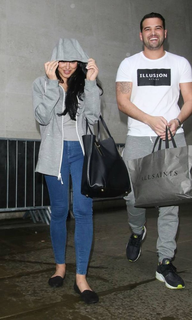19.FEBRUARY.2015 - LONDON - UK GEORDIE SHORE STAR MARNIE SIMPSON AND HER BOYFRIEND RICKY RAYMENT OF TOWIE ARE SEEN SHELTERING FROM THE RAIN AS THEY LEAVE THE BBC RADIO 1 STUDIOS IN LONDON, UK. BYLINE MUST READ : XPOSUREPHOTOS.COM ***UK CLIENTS - PICTURES CONTAINING CHILDREN PLEASE PIXELATE FACE PRIOR TO PUBLICATION *** UK CLIENTS MUST CALL PRIOR TO TV OR ONLINE USAGE PLEASE TELEPHONE 0208 344 2007**