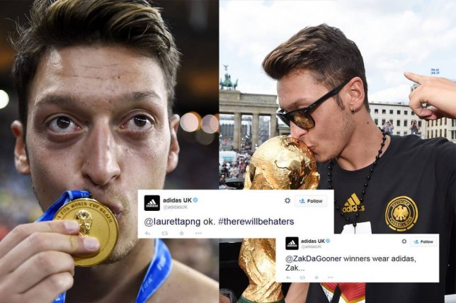 Germany's midfielder Mesut Ozil kisses his medal after Germany won the 2014 FIFA World Cup final football match between Germany and Argentina 1-0 following extra-time at the Maracana Stadium in Rio de Janeiro, Brazil, on July 13, 2014. AFP PHOTO / FABRICE COFFRINI