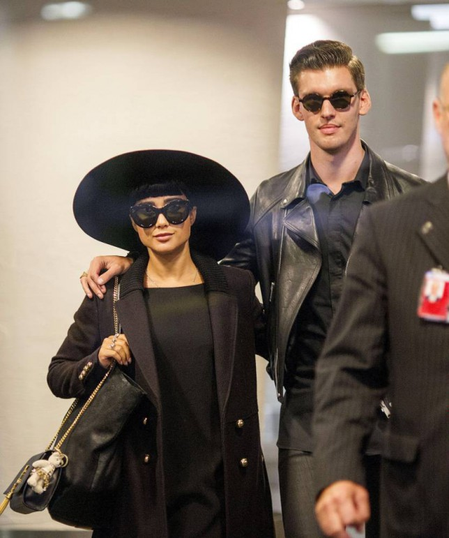 Mandatory Credit: Photo by Simon Runting/REX (4540577b)  Sacked NZ X Factor judges Natalia Kills and Willy Moon being escorted through Auckland Airport check in before fleeing the country to LA  Sacked X Factor judges Natalia Kills and Willy Moon leaving Auckland Airport, New Zealand - 17 Mar 2015
