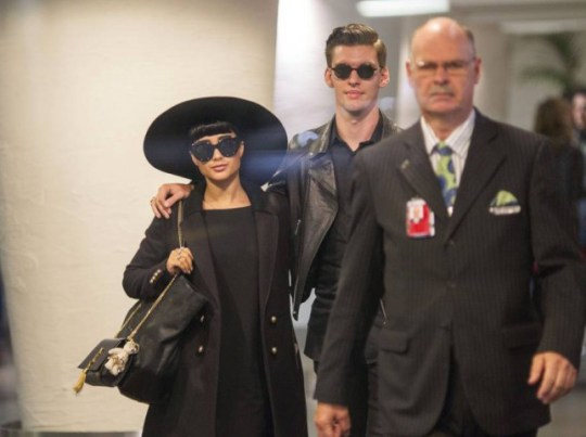Mandatory Credit: Photo by Simon Runting/REX (4540577a)  Sacked NZ X Factor judges Natalia Kills and Willy Moon being escorted through Auckland Airport check in before fleeing the country to LA  Sacked X Factor judges Natalia Kills and Willy Moon leaving Auckland Airport, New Zealand - 17 Mar 2015