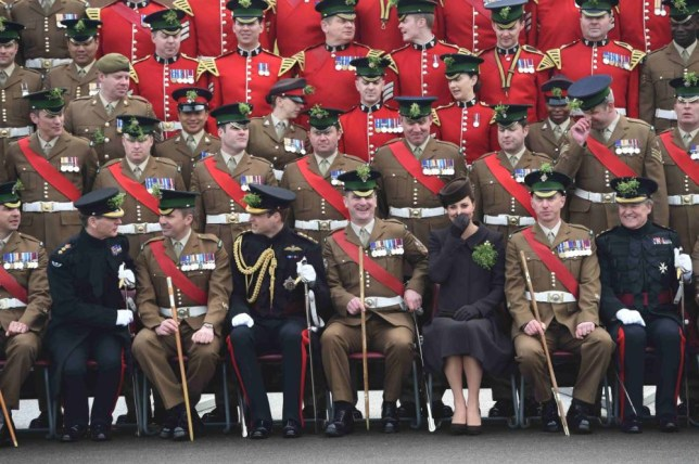 Britain's Prince William (front row 4th L) and his wife Catherine, Duchess of Cambridge (front row 3rd R), pose for an official photograph with 1st Battalion Irish Guards during a St Patrick's Day Parade at Mons Barracks in Aldershot, southern England March 17, 2015.   REUTERS/Eddie Mulholland/pool (BRITAIN - Tags: ROYALS ENTERTAINMENT MILITARY)