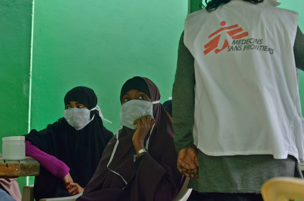 Young women suffering from tuberculosis, (TB) wait to receive their medication at a Medecins Sans Frontieres (MSF)-run clinic in Nairobi on March 24, 2015, World Tubeclosis Day. Globally, TB continues to kill 1.5 to 2 million people each year and remains the leading cause of death in people with HIV. In 2013, there were 90,000 new cases of TB diagnosed in Kenya and an estimated 20,000 cases went undetected. AFP PHOTO / TONY KARUMBATONY KARUMBA/AFP/Getty Images