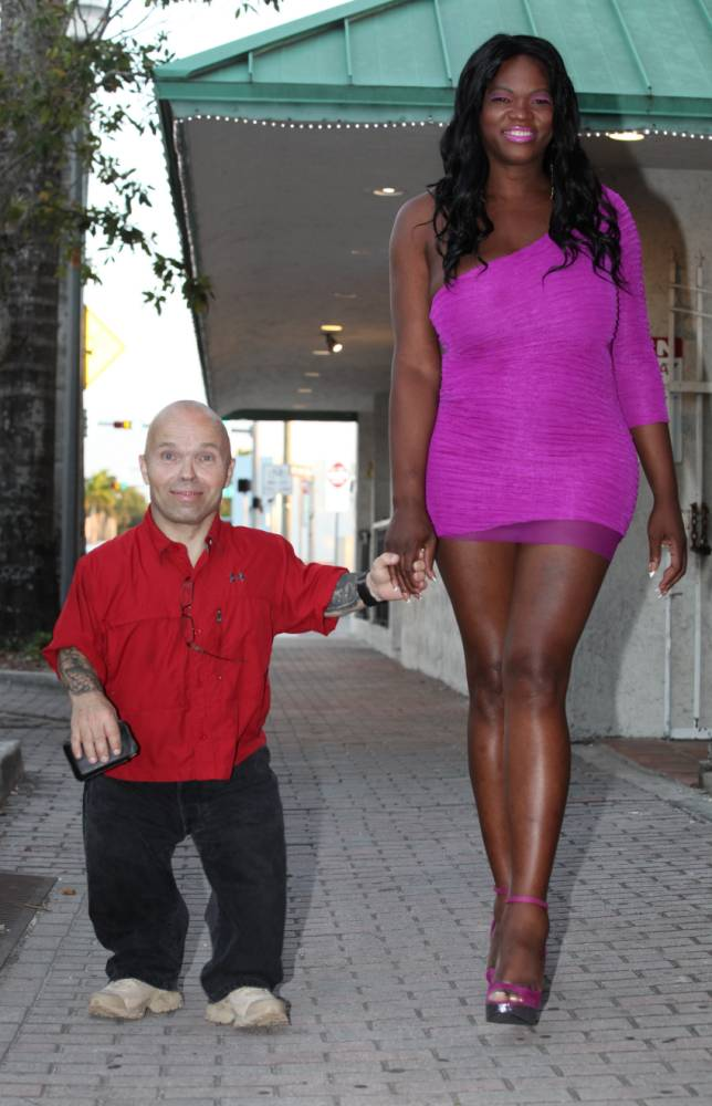 PLEASE NOTE ***ONLINE EMBARGOED UNTIL 00-01 MARCH 30, 2015*** *** EXCLUSIVE *** HOMESTEAD, FL - MARCH 4: Anton Kraft and China Bell together on a night out on March 4, 2015 in Homestead, Florida. 4ft 4in tall Anton Kraft has benched an incredible 36 stone - earning him comparisons to the Marvel character Ant-Man, who is about to be immortalised by Hollywood. He also punches above his weight with the ladies, only dating women who are more than a foot taller than he is. And for the past six months he has been overachieving again - by dating 6ft 3in China Bell. Anton, 52, has been powerlifting for 10 years and says he has highest bench press record of all time for his weight class.  PHOTOGRAPH BY Ruaridh Connellan / Barcroft USA UK Office, London. T +44 845 370 2233 W www.barcroftmedia.com USA Office, New York City. T +1 212 796 2458 W www.barcroftusa.com Indian Office, Delhi. T +91 11 4053 2429 W www.barcroftindia.com