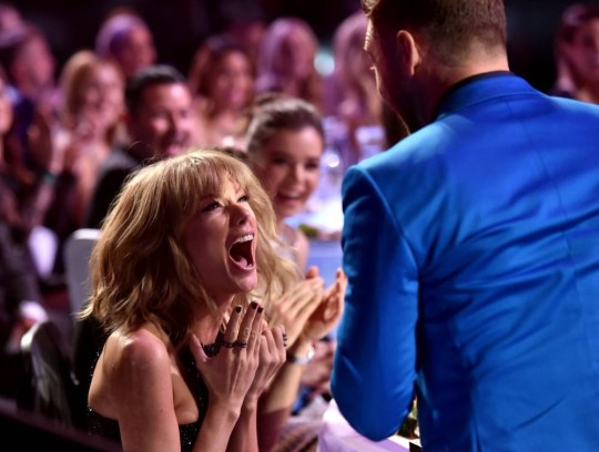 LOS ANGELES, CA - MARCH 29:  Singer/songwriter Taylor Swift (L) reacts to winning the Best Lyrics award for 'Blank Space' with singer Justin Timberlake in the audience during the 2015 iHeartRadio Music Awards which broadcasted live on NBC from The Shrine Auditorium on March 29, 2015 in Los Angeles, California.  (Photo by Kevin Winter/Getty Images for iHeartMedia)