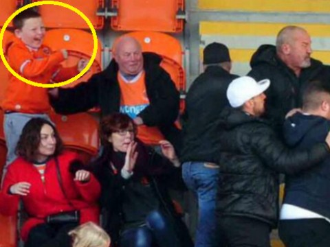 Blackpool and Leeds fans fight in stand, this kid absolutely loved it