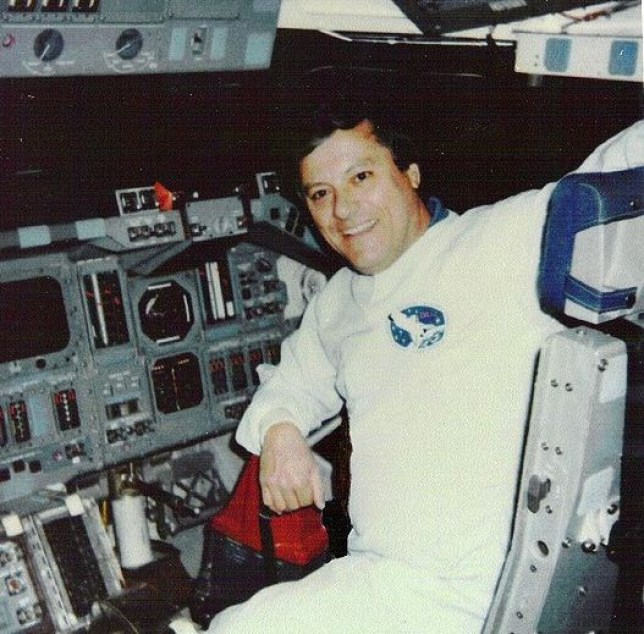 Clark McLelland sits on the Space Shuttle (Picture NASA)