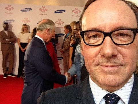 'He's behind you!' Kevin Spacey can't resist taking a selfie as he meets Prince Charles