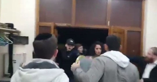 Six men have been arrested after the incident at a synagogue in Stamford Hill (Picture: YouTube)